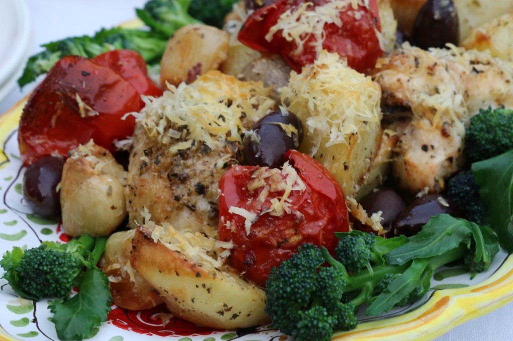 Parmesan baked chicken with potatoes, tomatoes