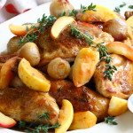 Chicken braised in cider with buttered apples